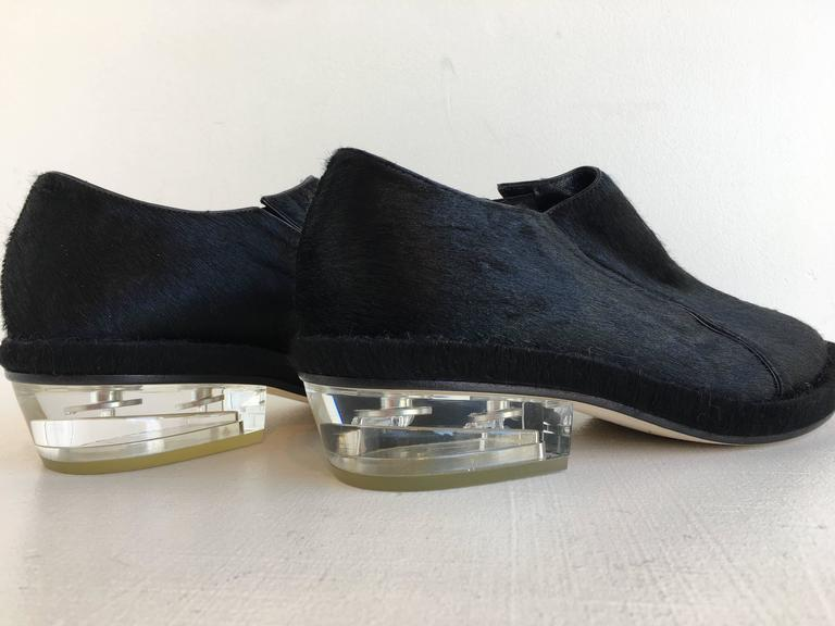 Simone Rocha black pointy toe pony-hair shoes with clear 1.5 inch resin heel.