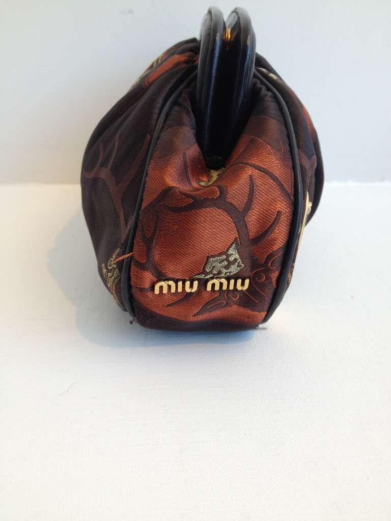 Miu Miu Burnt Orange and Black Clutch 3