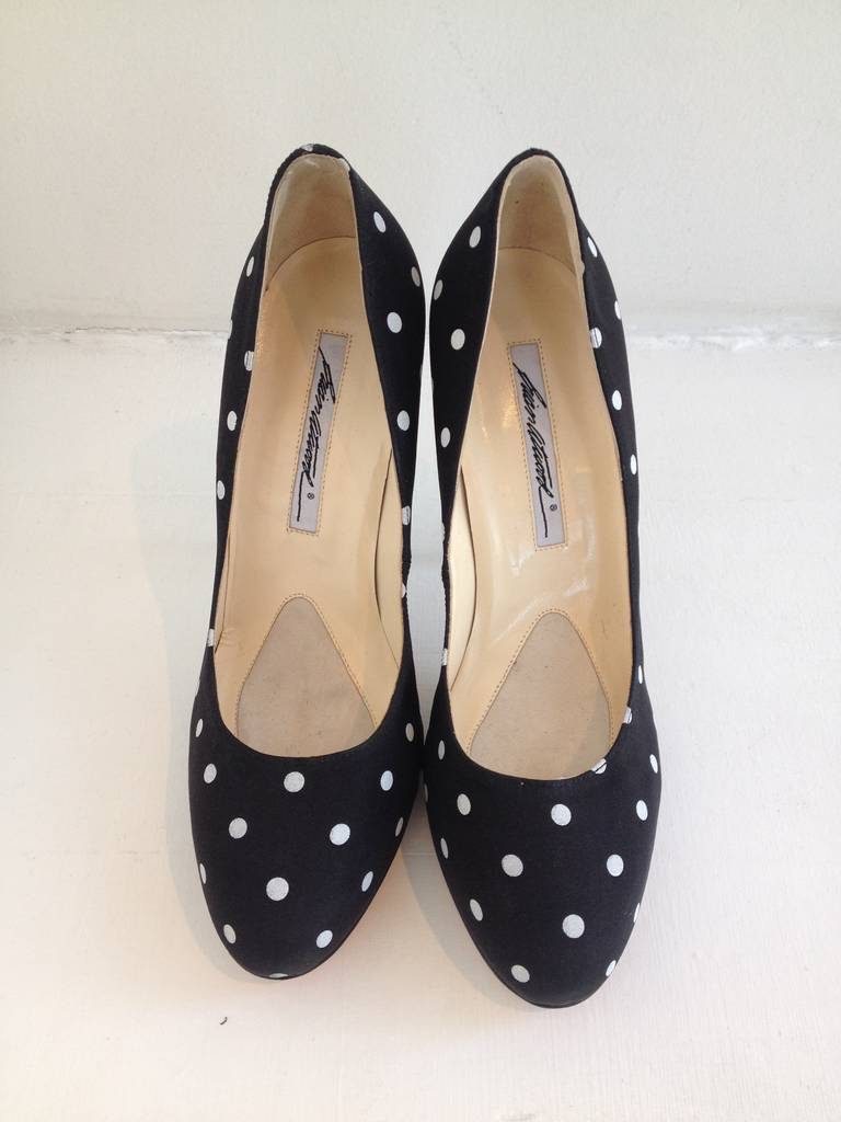 Look perfect in polka dots!  These adorable pumps will add a flirty accent to any outfit. Wear with a full flouncy skirt for a 1950's vibe or dress up a pair of camel trousers with the classic, fun print. The pumps have a 5 inch heel.