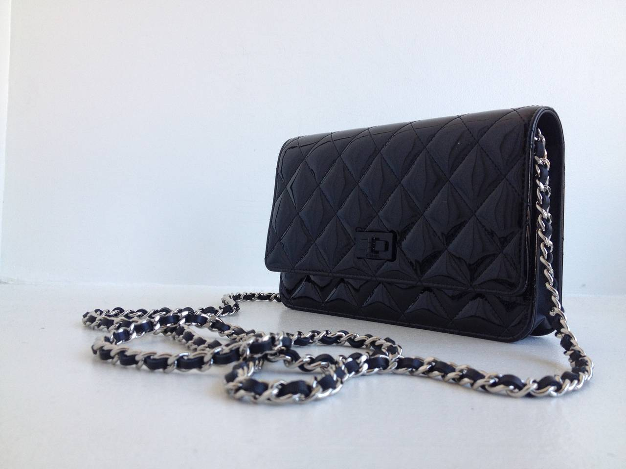 b36f0053c9b Chanel Black Patent Mini Clutch Purse For Sale. There s nothing more  perfect than classic Chanel! This little clutch pays homage to the legendary