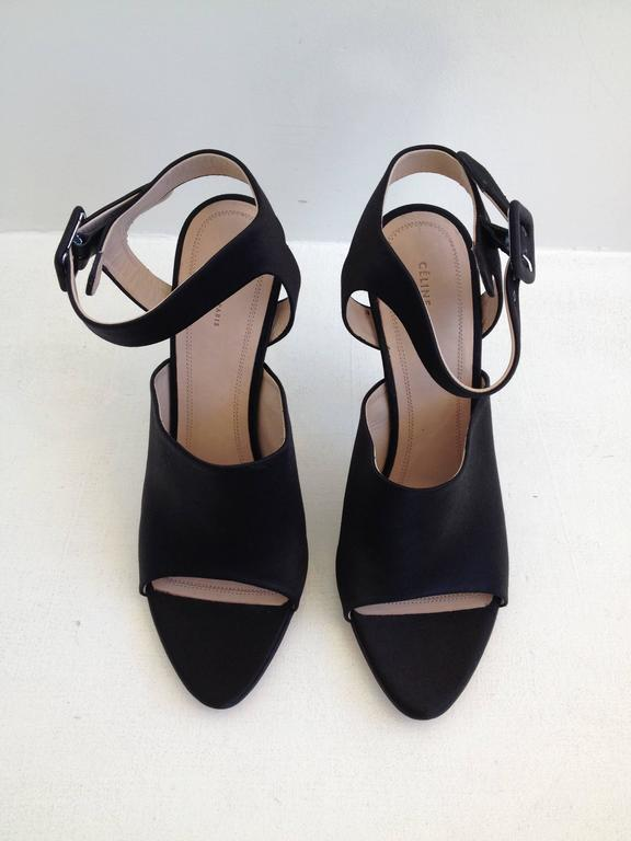 Modern, architectural, and edgy, they're beautiful and cool at the same time. The front is mule-like but with a cutout toe, while the back has a wide ankle strap and a high 4.5 inch stiletto heel. So sleek!