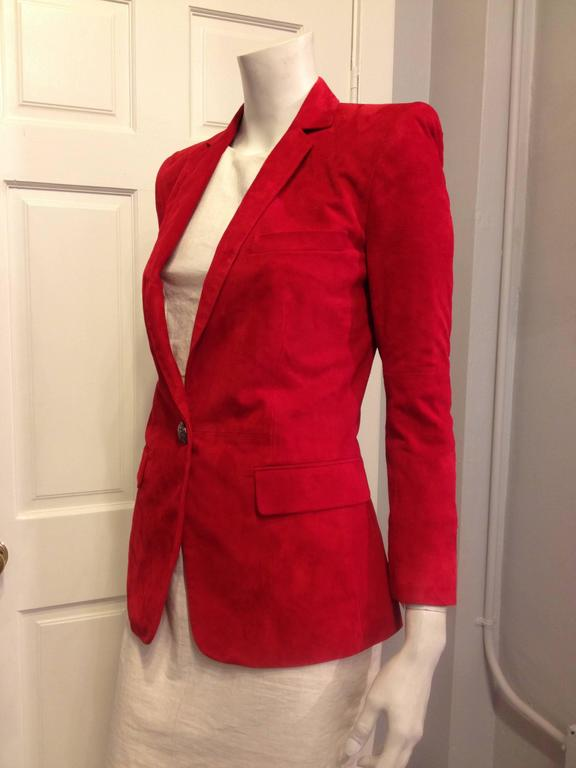How iconic! A red suede blazer cut as sharply as this one is instantly so rock & roll, especially when it's made by Balmain. The shoulders are super-sculpted in the signature Balmain way, and the sleeves are slightly cropped for a shrunken fit. The