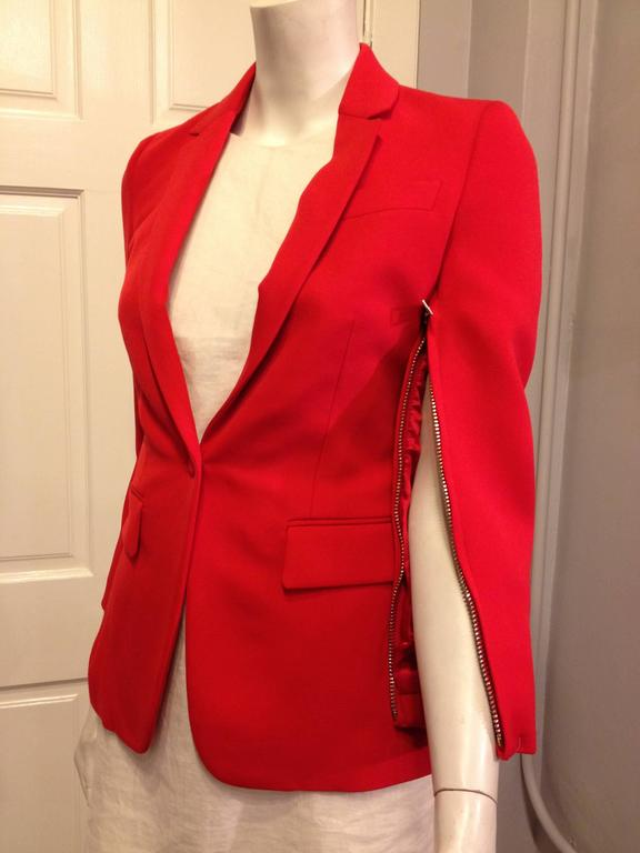 The absolutely gorgeous cut of this blazer is even more perfect in a vibrant, lush orangey red vermillion. The modern single button closure cinches the waist, while the slender lapels and hip pockets create an hourglass shape. The underside of each