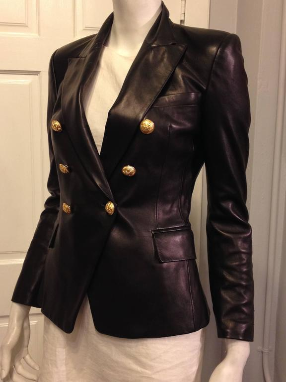 Black jacket with gold buttons