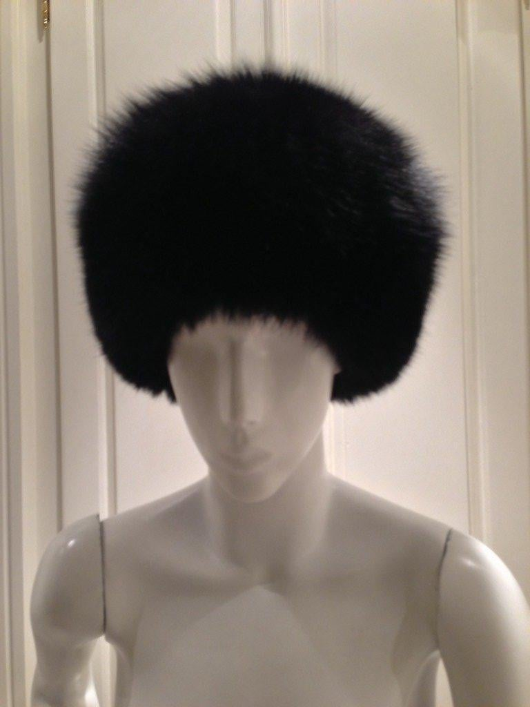 Stay warm and always look fabulous with this black Eric Javits Mink hat.  The soft fur is lined in a rich red satin fabric.  Perfect for cold winter days and nights as you explore the streets of the city.  Circumference 21 inches