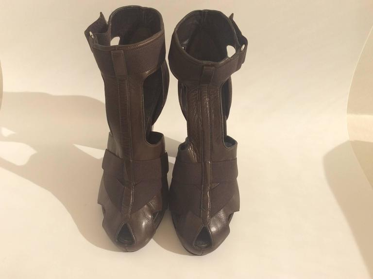These Givenchy leather dark brown sandals will compliment any women's foot. With it's .5inch platform, 5inch heel and elastic straps these would be perfect for a night out on the town.