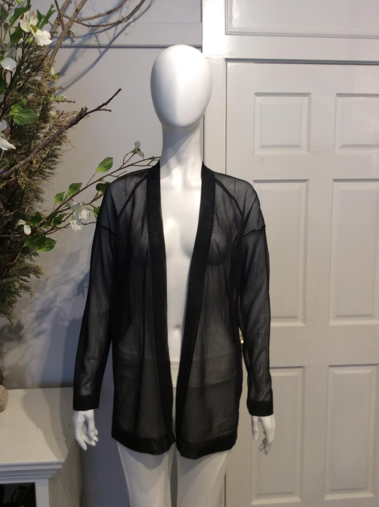 Black Alaia black silk sheer open cardigan. New with tag and never worn. Original retail price of $1565.  Sizing: Fr36, Us4  Fabric content: 100% Silk