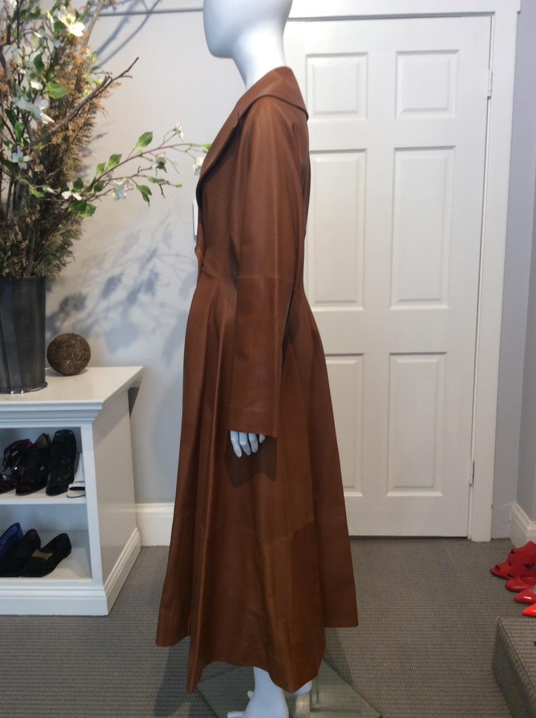 The Row runway Fall 2016 long caramel leather fitted double breasted trench coat with flared skirt with two hidden hooks at the waist size 6. Retail $13000
