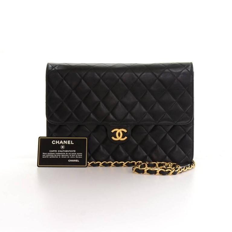 Chanel black quilted leather bag. It has flap with CC logo stud lock on the front. On the inside, it has Chanel red leather lining with one zipper pocket. It can be used as shoulder bag or clutch.  Made in: France Serial Number: 6133196 Size: 9.8