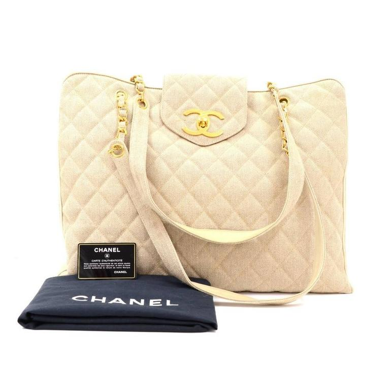 Chanel Weekender Tote in beige quilted canvas outside and botom and inside lambskin leather with silk lining. Top is secured with small flap with large CC twist lock. It is split into 3 compartments and middle is secured with zippers which d has 2