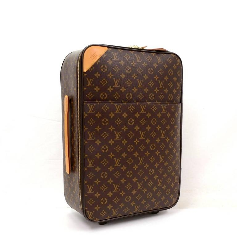 Louis Vuitton Pegase 50 a classic from the Louis Vuitton rolling travel bag collection. It has 1 exterior slip pocket with zipper. Top has double zipper for secure and easy access. Inside has 1 zipper pocket. Great for any trip! It comes with name