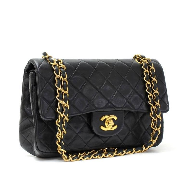 563082f782c2 Vintage Chanel 2.55 9 inch Double Flap Black Quilted Leather Shoulder Bag  at 1stdibs