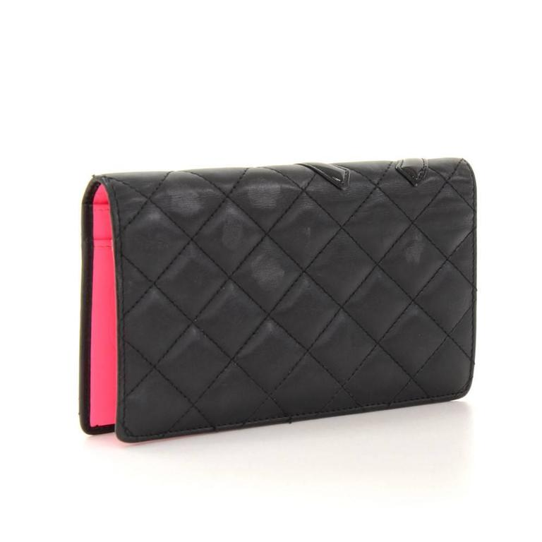 Chanel quilted lambskin leather wallet. Inside is in pink leather lining with 1 coin case with zipper, 2 compartments for note, 2 open pockets and 8 card slots. Very cute and make great companion where you go!  Made in: Italy Serial Number: