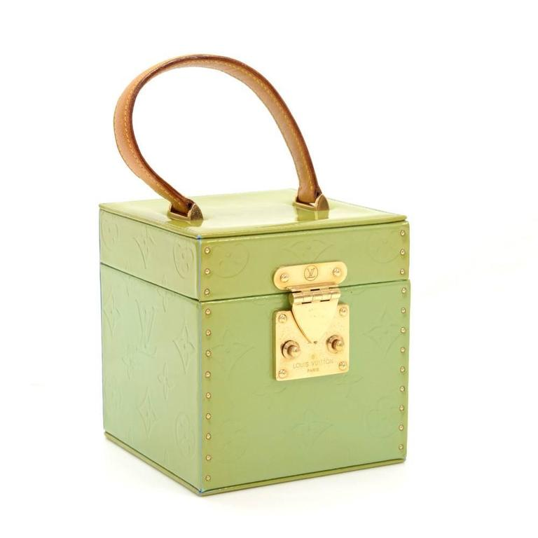 This is Louis Vuitton Vernis Leather Bleeker Jewelry Box. Front is secured with lock and latch. Inside has leather lining and on the flap is mirror. A very rare discontinued item!   Made in: France Serial Number: AA 1908 Size: 4.3 x 4.3 x 4.5