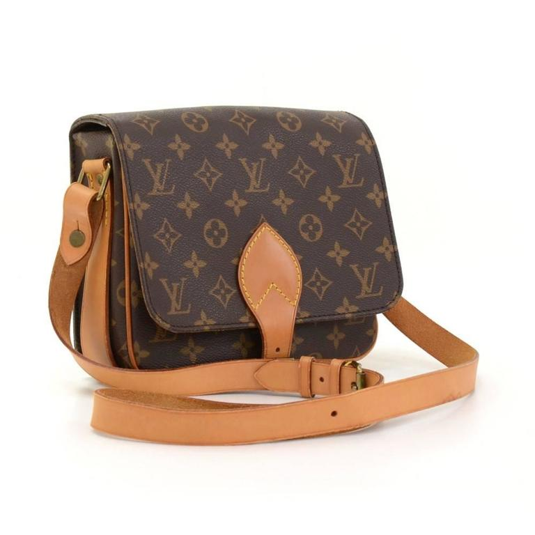 Louis Vuitton Cartouchiere Mm In Monogram Canvas Flap Top Secured With Belt Closure Inside
