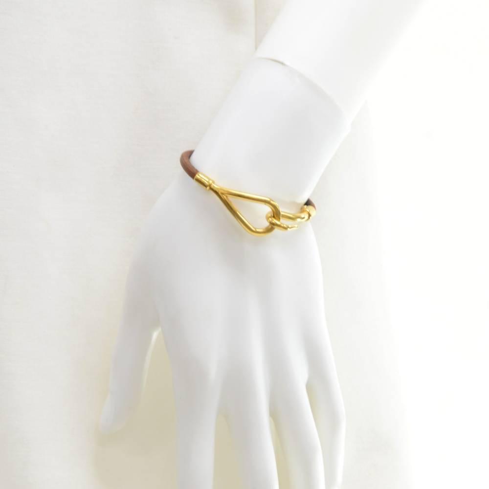 constance hermes wallet - Hermes Brown Leather x Gold Tone Hook Jumbo Bracelet at 1stdibs