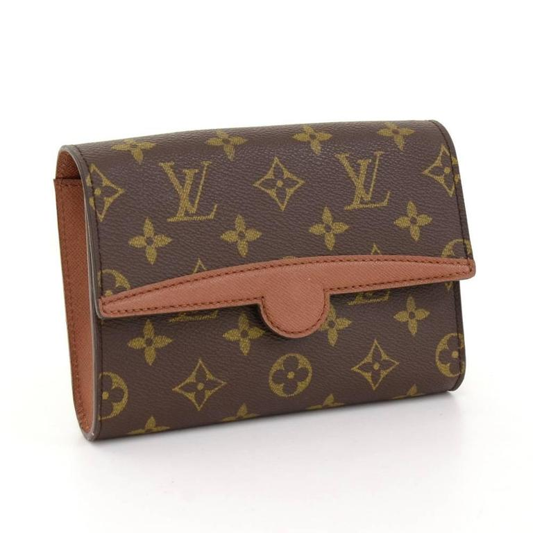Louis Vuitton Pochette Arche in monogram canvas. Flap top with stud closure. It can also be worn around the waist on the leather belt. Very stylish!Belt is not included.  Made in: France Serial Number: MI0975 Size: 6.7 x 4.7 x 1.4 inches or 17 x
