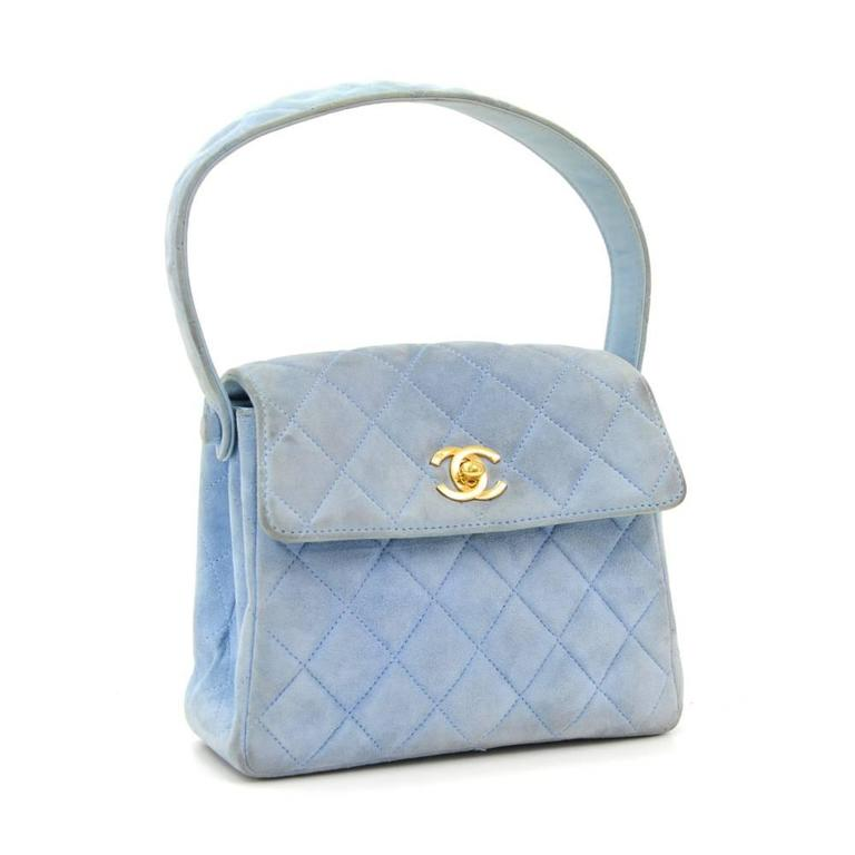 Chanel bag in light blue quilted suede leather. Flap top with CC logo twist closure and 1 open pocket on back. Inside has llambskin eather lining with 2 compartment and 1 open pocket. Wonderful statement bag wherever you go!  Made in: