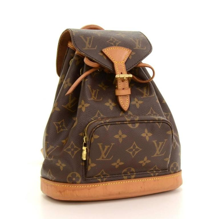 Louis Vuitton Mini Montsouris backpackin monogram canvas. It has 1 zipper pocket on the front. It has leather string closure with flap top for security. Spacious and classy, it would make a great companion wherever you go!