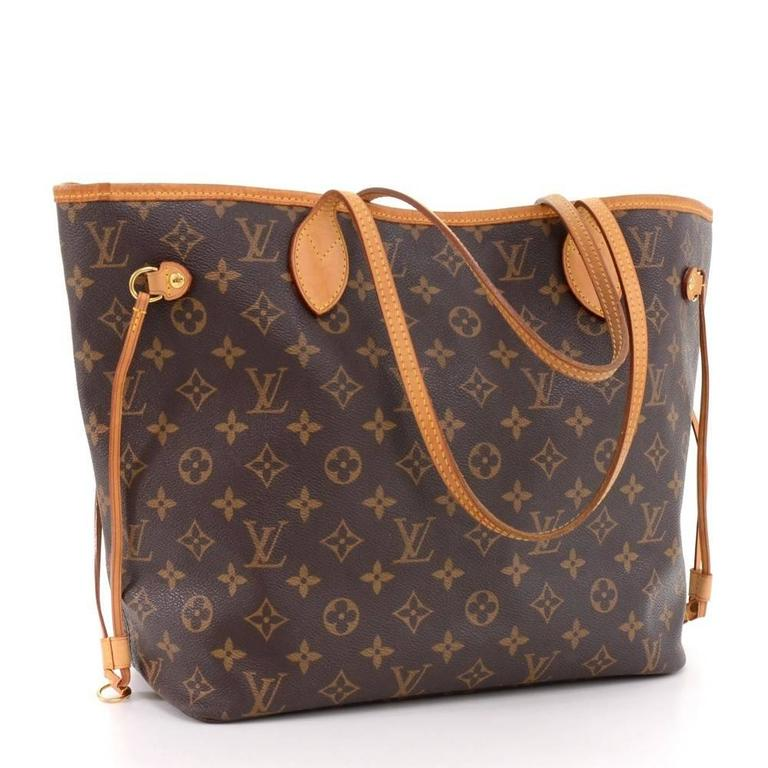Louis Vuitton Neverfull MM tote bag in monogram canvas. Inside has 1 zipper pocket. Comes with D ring inside to attach small pouches or keys.  Made in: France Serial Number: AR1097 Size: 12.6 x 11.4 x 6.5 inches or 32 x 29 x 16.5 cm Shoulder