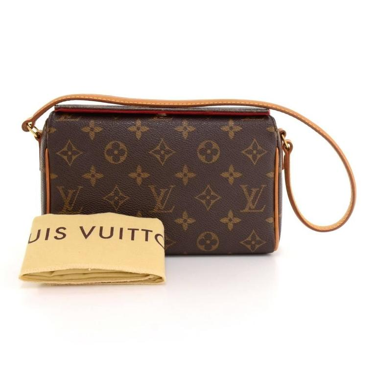 Louis Vuitton Recital handbag in Monogram canvas. It has magnetic closure on top. Inside has red alkantara lining with 1 open pocket. Very cute with any outfit.
