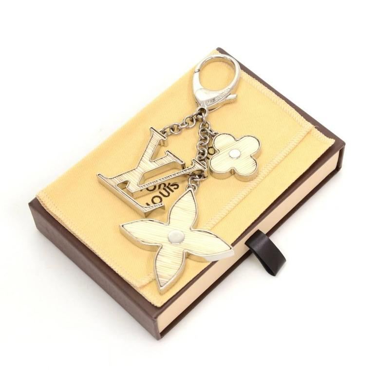 Louis Vuitton Key holder/Bag charm. Rare design would make your keys easy to find. Would as well look great hanging on your bag.