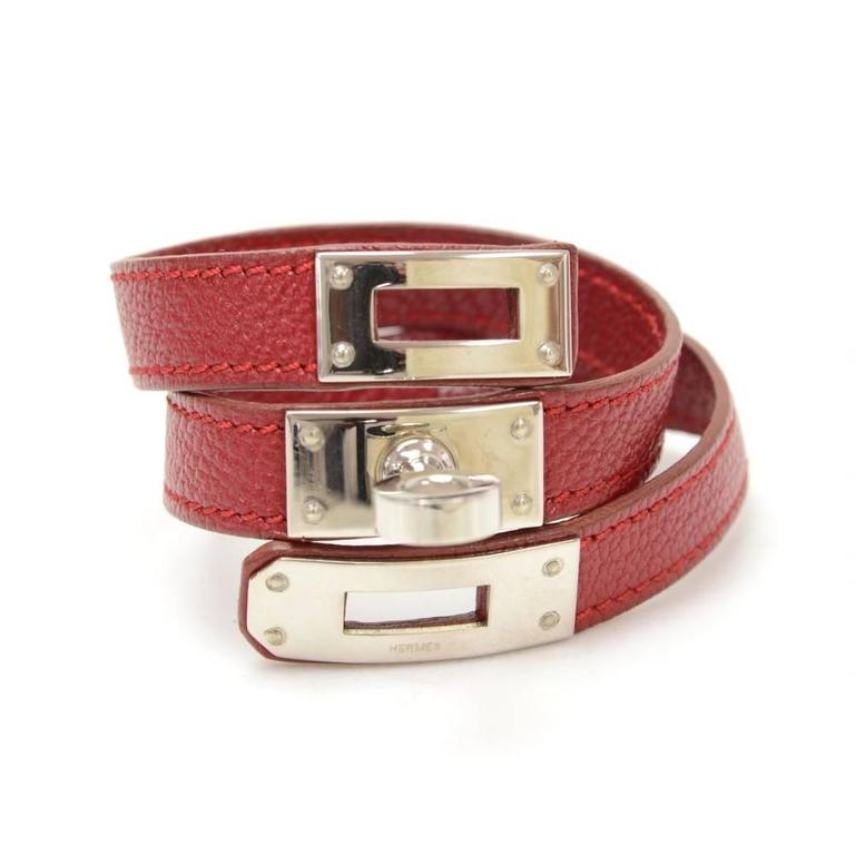 Hermes Kelly bracelet in burgundy leather. Hermes Paris Made in France is engraved on inside. It is very stylish and great statement wherever you go. 