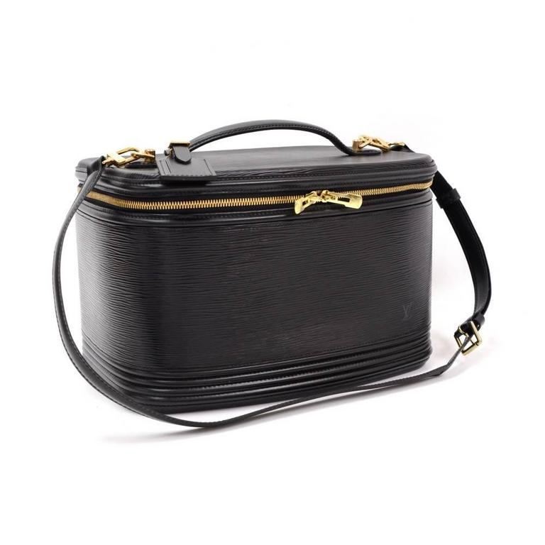 Louis Vuitton Black Vanity cosmetic bag in Epi leather. Top flap closure is secured with double zipper. Inside has a separator to create 2 floors with mirror and leather belt to keep the bottles in standing position. Handheld or carried on shoulder