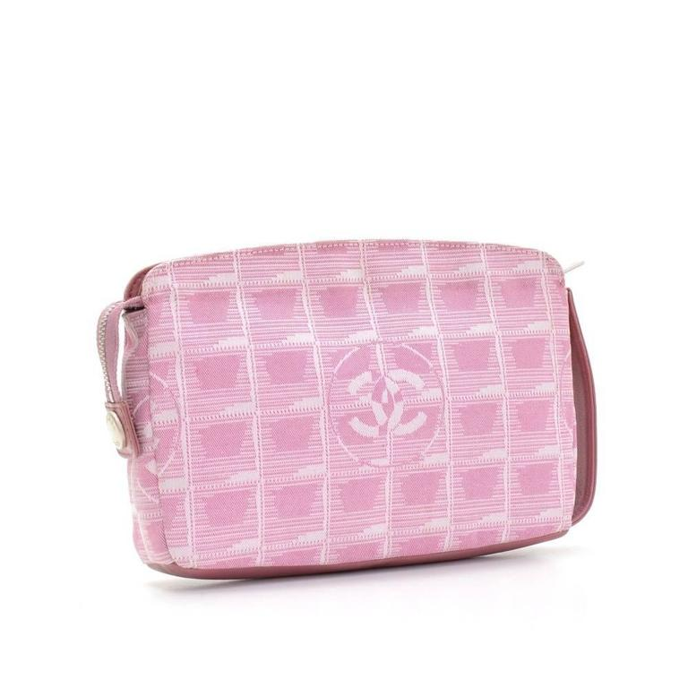 Chanel Travel Line bag in pink Jacquard nylon. Top has zipper closure. Inside has beige washable lining. This stunning bag lightweight and easy access.   Made in: France Serial Number: 6444838 Size: 7.9 x 5.5 x 1.2 inches or 20 x 14 x 3 cm Color: