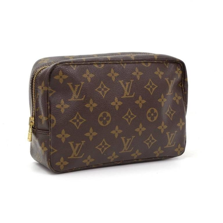 Louis Vuitton Trousse Toilette 23 cosmetic pouch in monogram canvas. Top access is secured with zipper. Inside has washable lining, 1 open pocket and 3 rubber bands to hold bottles. Very practical item to have!  Made in: France Serial Number: TH