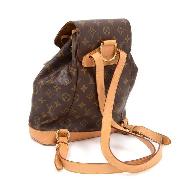 Louis Vuitton backpack Montsouris MM in Monogram canvas. It has 1 external zipper pocket on the front. Leather pull string closure with flap top for security and 1 interior open pocket. Discontinued model.  Made in: France Serial Number: