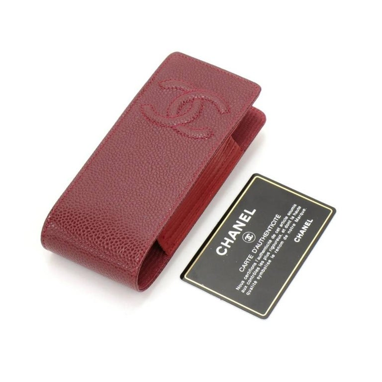 Chanel red caviar leather case/pouch to carry phone, cigarettes or digital cameras. Inside is in textile lining. Very smart and stylish.   Made in: France Serial Number: 7468331 Size: 5.5 x 2.4 x 1.2 inches or 14 x 6 x 3 cm Color: Red Dust bag: