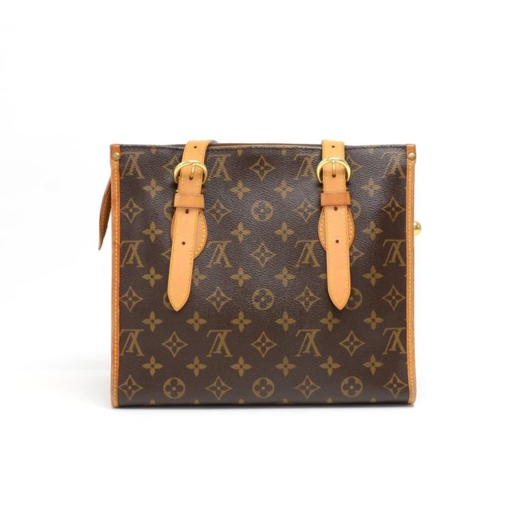 Louis Vuitton Popincourt Haut bag in Monogram Canvas. Top secured with zipper and nice orb charms attached to the zipper pull. Inside is in brown canvas lining with 1 open pocket and 1 for mobile or glasses. Comfortably carry in hand or on shoulder.