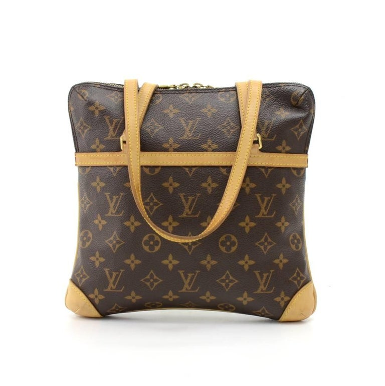 This is Louis Vuitton Coussin GM shoulder Bag in monogram canvas. It has double zipper closure and 1 exterior open pocket. On the inside has red alkantra lining with 1 open pocket and 1 for mobile. Great size to keep you organized.  SKU: LO489  Made
