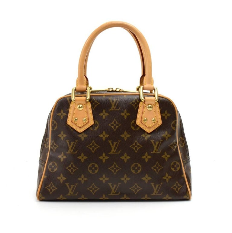 Louis Vuitton Manhattan PM in monogram canvas. Main access is secured with double zippers. Outside has 2 pockets with clutches. Inside has alkantra lining and 1 open pocket. It is very hard to overlook this bag!SKU: LO526  Made in: France Serial