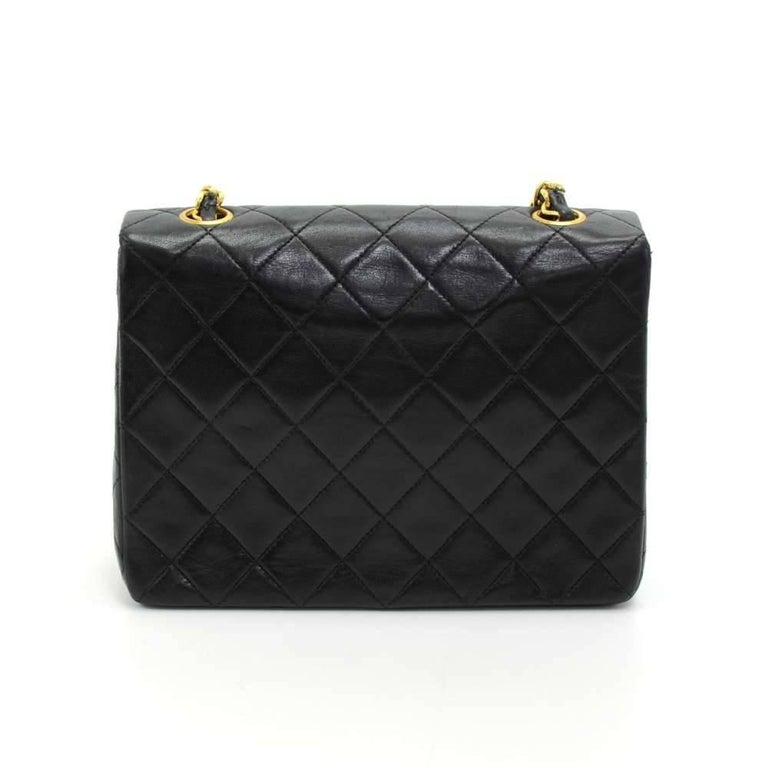 Vintage Chanel black quilted leather mini bag. It has flap and CC twist lock on the front. Inside has Chanel red leather lining and 2 pockets; 1 zipper and 1 open slit into 3 compartment. It can be carried on the shoulder or across the body with the