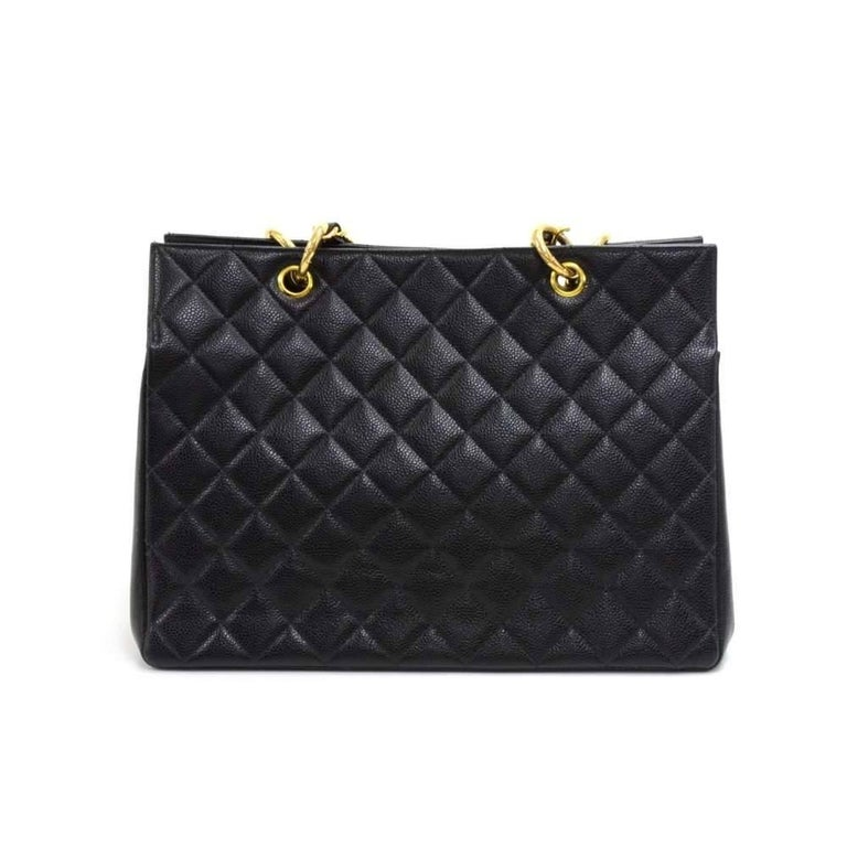 Vintage Chanel shopping tote bag in black quilted caviar leather. Outside has a large classic CC logo stitched on like the medallion style bags. It has an open access. Inside has a very spacious interior with black leather lining and one zipper and