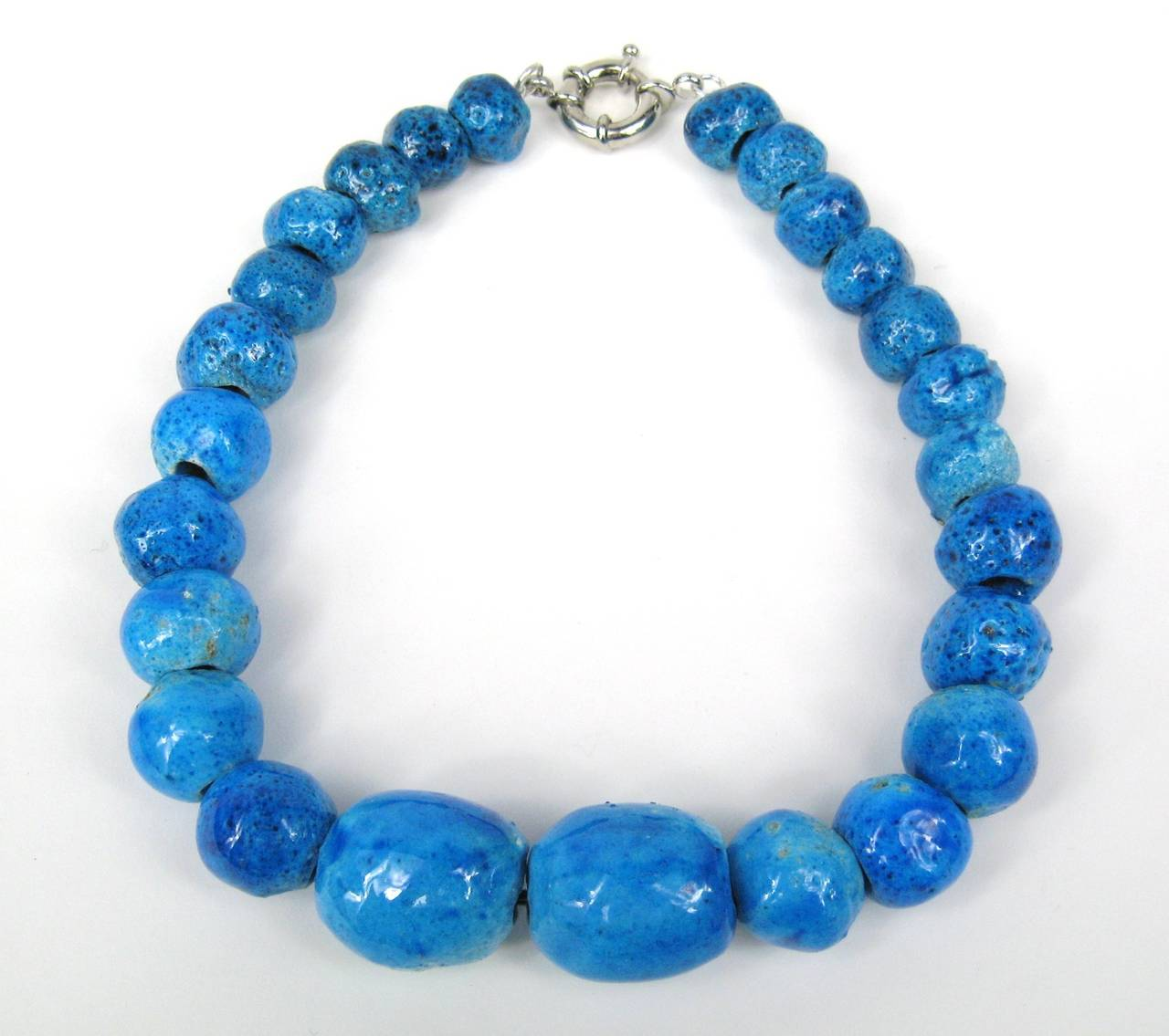 """Ceramic Beads Graduating in size from  29.85mm w x 23mm down to 11.mm w x 17mm Color is Fantastic, Deep Blue Measuring 18"""" end to end Any questions please call or hit """"request more information"""""""