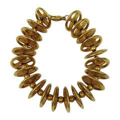 1990s ROBERT LEE MORRIS Pin Wheel Gold Gilt Bracelet New, Never worn