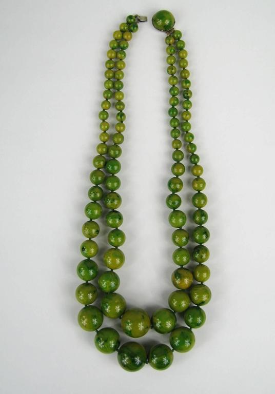 Stunning graduated Bakelite / Catalin Necklace  Original 1930s  Bakelite, not a new reproduction  Slide in clasp  Measuring  23 inches end to end on the smaller strand Drops down to 26 inches  Beads measure 24.32 mm down to 8.96 mm Any questions
