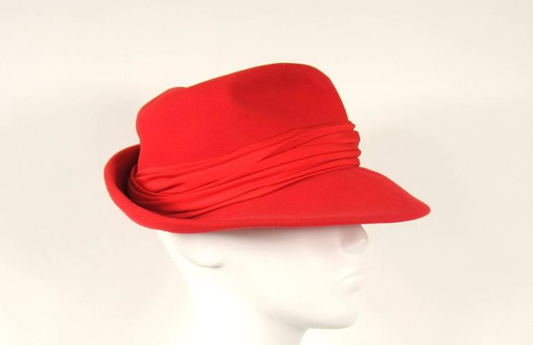 Stunning bold Red Fedora Saks 5th Ave  1960s  Wool  23.5 in  Brim 3 in Large Ribbon around crown of hat  Any questions please call, email or hit request more information