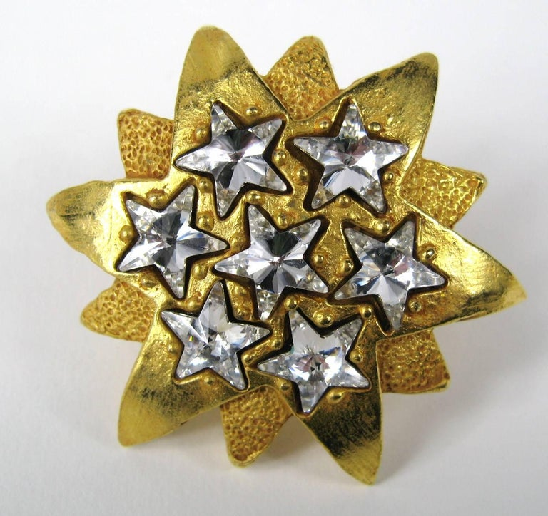 Dominique Aurientis Gold Gilt Crystal Star Clip on earrings, what a dynamic design. Circa 1980s Created by famed Parisian designer Aurientis. Measuring 1.9 in diameter. This French jewelry designer has a vast international customer base and is known