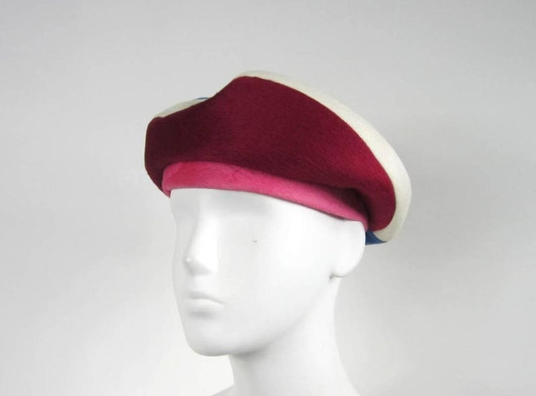 Stunning 1960s Beret in Pink Blueish Purple and Burgundy with a amazing ribbon on top. Hat is  21.5 inches in diameter. Any questions please call, email or hit contact. Please check out our store front for more stunning pieces of clothing and