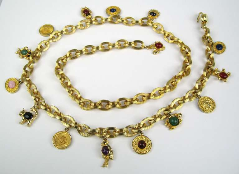 Judith Leiber gold gilt chain link belt with semi precious cabochon stones set in frogs, owls and birds and charms. Measuring 42 inches end to end  This is out of a massive collection of Hopi, Zuni, Navajo, Southwestern, sterling silver, costume
