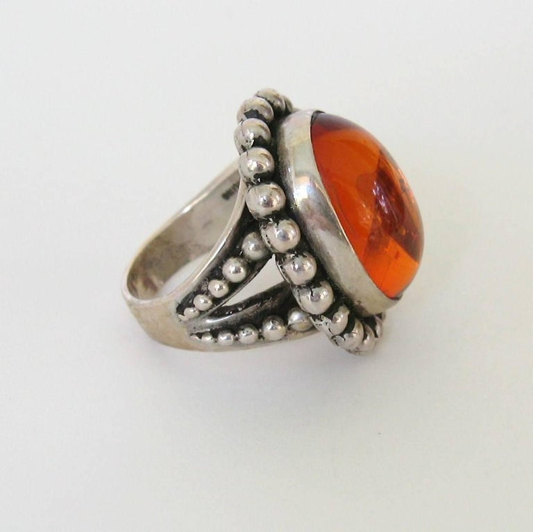 Fabulous Large Amber Sterling Ring with a Bezel Set Amber- Beaded Motif Surrounding Stone. With a  Substantial amount of sterling makes up this Ring    Hallmarked Stephen Dweck & Sterling Silver. Measuring 1.07 x .90  Size is 6.5. Stephen Dweck has