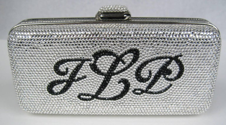 Judith Leiber Monogram Hinged Hard Shell Clutch JLP Double sided Black and Silver crystals. Measuring  3.5 H x 6 W x 1 3/4 D 50 inch chain. New with Tags. Be sure to check our store front for more fabulous pieces from this collection. We have been