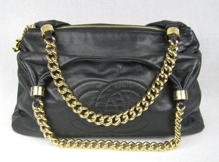 f68a1072ed12 ... Lambskin Gold Chain Handbag For Sale. Stunning black Chanel leather  with thick gold tone chain. front logo Middle zippered closure with