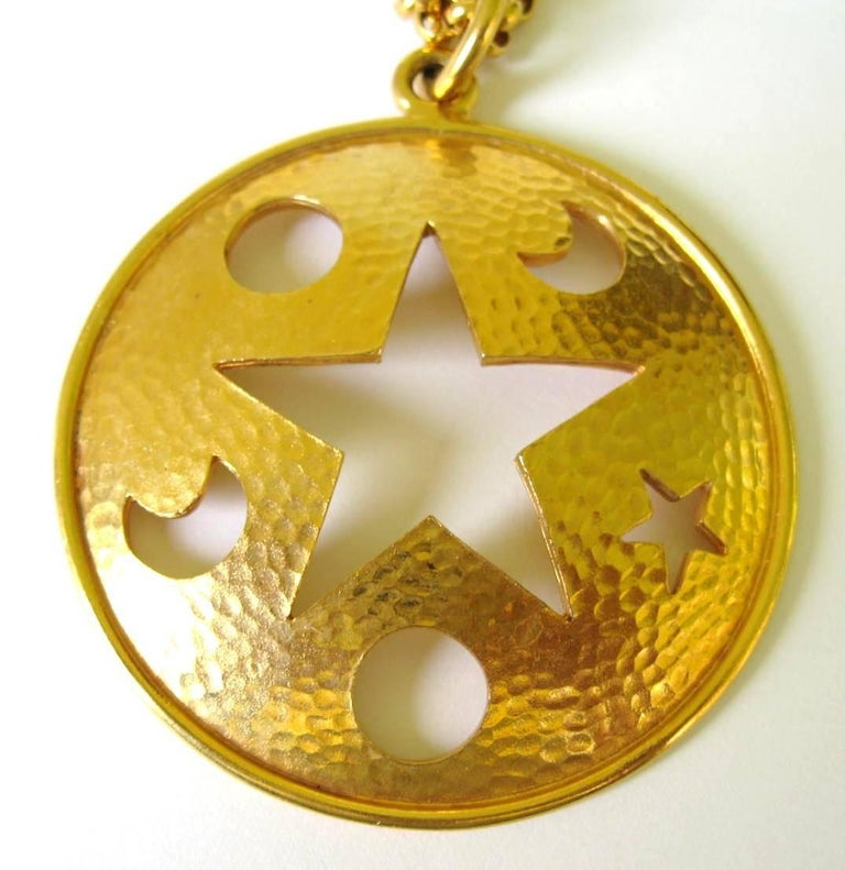 Huge Celine Disc Star cutout necklace designed by Celine. 32 inch long chain. 3 inch diameter disc. This is out of our massive collection of Hopi, Zuni, Navajo, Southwestern, sterling silver, costume jewelry and fine jewelry from one collector. Be