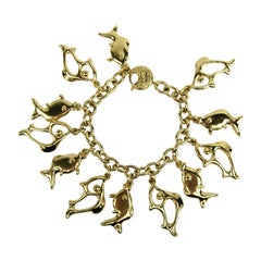 1980's Yves Saint Laurent YSL Gold Fish Charm Bracelet New Never worn