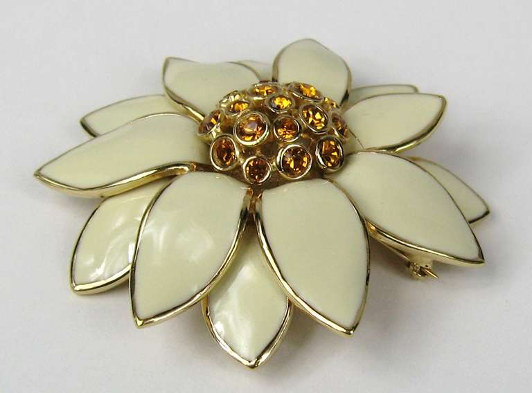 Another piece of Stunning Ciner. Amber Swarovski Crystal in the center of a floral brooch with enamel leaves. Measuring 2.60 w x 2.40 top to bottom. This is out of a massive collection of Hopi, Zuni, Navajo, Southwestern, sterling silver, (costume